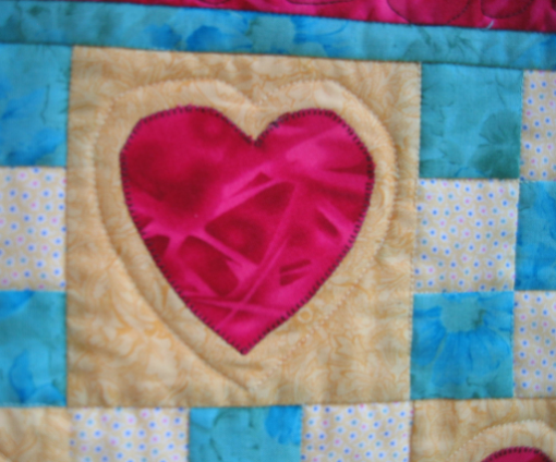 Detail of Blanket of Love quilt