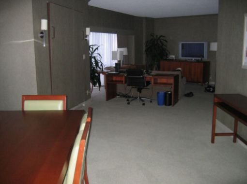 The Westin in Seattle -- looking from dining area past the Murphy bed in the wall and the office desk to the living room