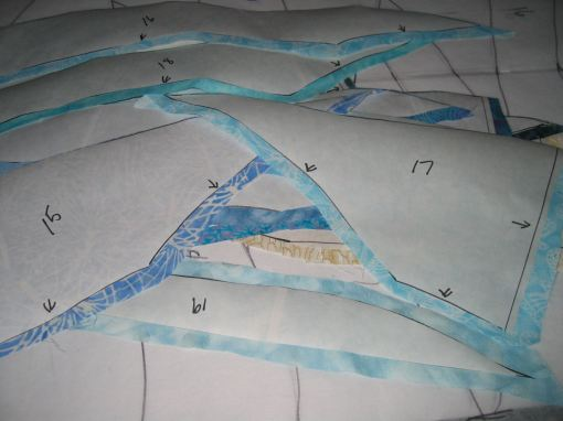 Iron freezer paper to fabric then cut out fabric pieces