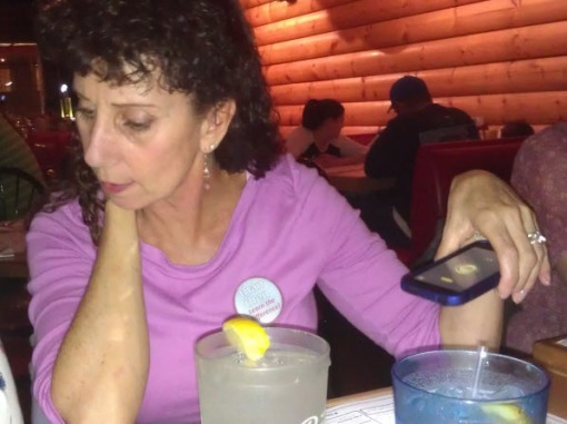 It was dim, so Sue used her phone's flashlight to illuminate her menu