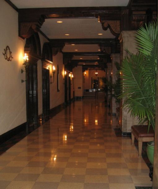 Marble corridor to function rooms on the mezzanine floor above the lobby