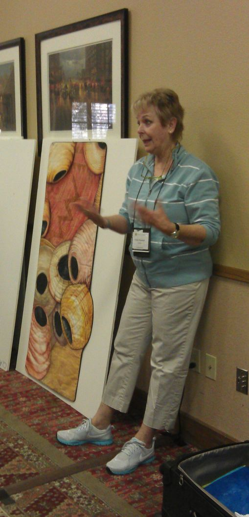 Velda explaining how she did her African baskets quilt
