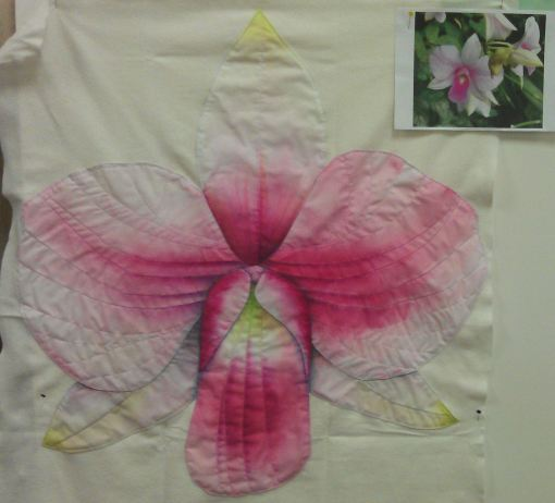 After initial outline stitching/stitch in the ditch in invisible thread