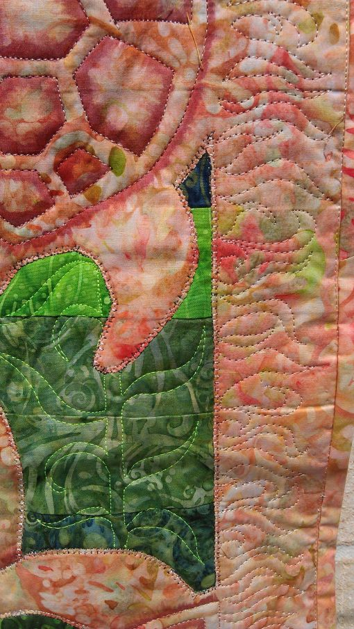 Detail of the shading, kelp, blanket stitch edge over the raw applique edge, and the binding