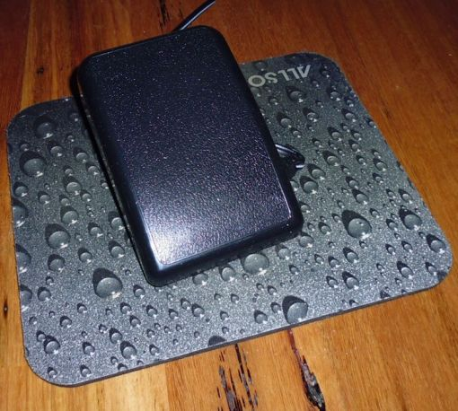 Foot controller with Velcro feet sticks to the neoprene mat, which sticks to the wooden floor