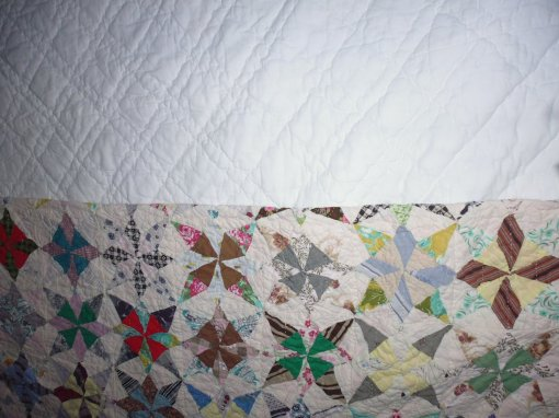 Two of the antique quilts on my bed at the cottage