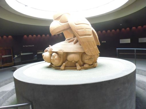 Bill Reid's 4-tonne yellow cedar creation story sculpture -- after the great flood, raven finds a clam shell containing children. The sand is from Rose Spit in the Haida islands where this story comes from.