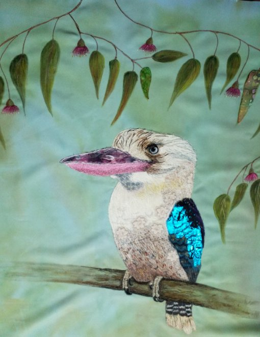 The kookaburra is finished! Notice that the yellow flower fabric on the neck is now gone. I added a small cream and apricot Liberty print to cover it and stitched over it to blend it in. The shiny blue fabric was some lycra I picked up in the dance fabrics section