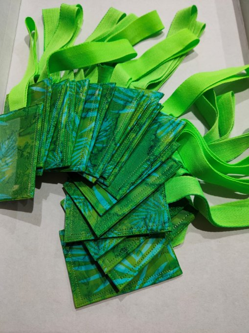 20 completed luggage tags, in green fabric with neon green loops