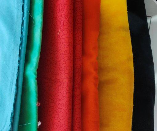 blue, green, red, orange, yellow and navy/black fabrics