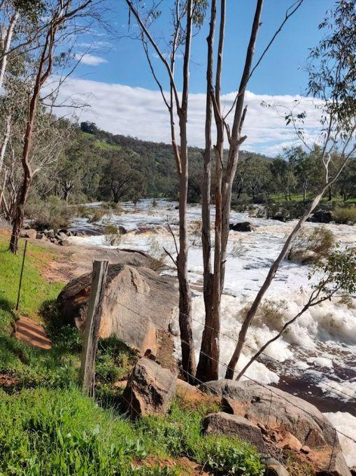 Avon River in full flow across rapids
